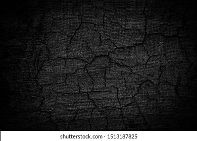 Burnt wooden Board texture. Burned scratched hardwood surface. Halloween backdrop. Smoking wood plank halloween background.