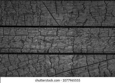 Burnt wooden Board texture.  Smoking wood plank background. Burned scratched hardwood surface.