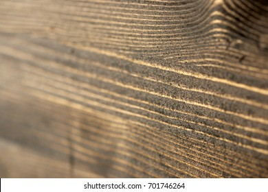 Burnt-out wood surface treated with impregnation
