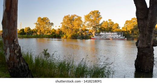 BURONGA, NEW SOUTH WALES, AUSTRALIA:  River Murray near Mildura with a moored historic riverboat or paddle steamer, reflecting the immense recreational and tourism value of the Murray-Darling.