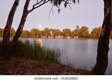 BURONGA, NEW SOUTH WALES, AUSTRALIA: Moonrise over the River Murray near Mildura with moored houseboats, reflecting the immense recreational value of the Murray-Darling River system.