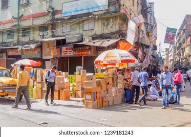Burrabazar, Kolkata, India, Asia MAY, 2017: Many local native vendor, trader, people walking in busy street market on a labor day. Burrabazar ( Bara Bazaar) largest wholesale marketplace in India.
