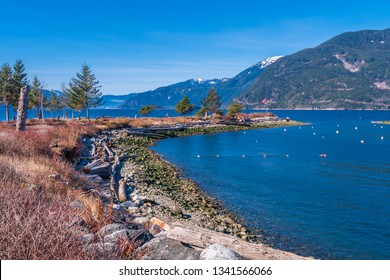 Burrard Inlet, ocean and island with mountains in beautiful British Columbia. Canada.