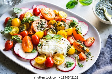 Burrata with colorful Cherry Tomatoes Salad with homemade Pesto
