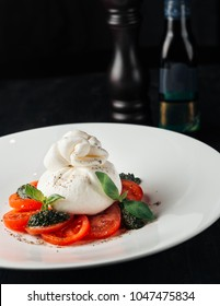 Burrata with tomatoes and greens