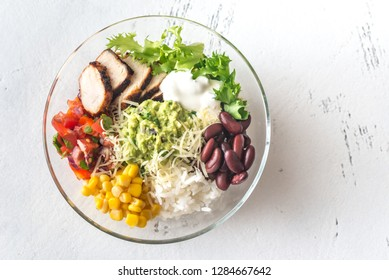 Burrito bowl with chicken, salsa, corn, rice, kidney beans and guacamole