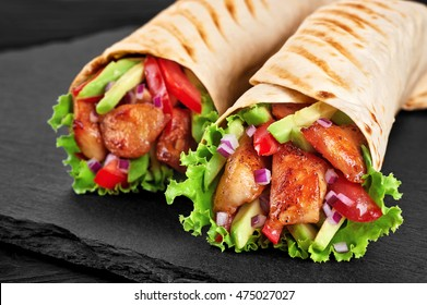 Burrito with grilled chicken and vegetables (fajitas, pita bread, shawarma)
