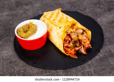 Burrito with meat and sauce