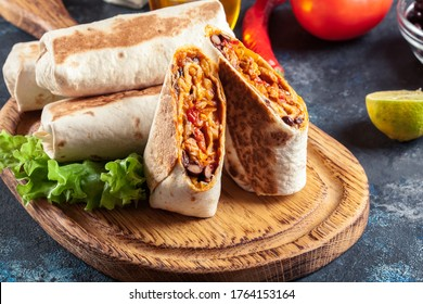 Burritos wraps with mincemeat, beans and vegetables. Mexican dish