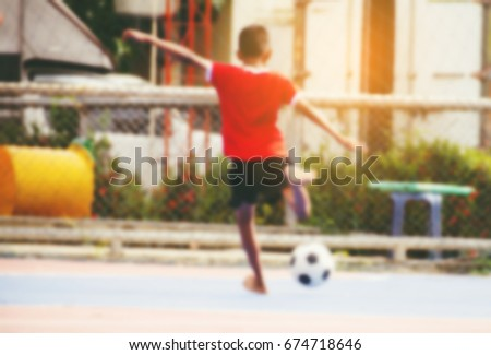 Burrymotion Blur Children Without Shoes Playing Football Stock Photo ... 7ff7978725b