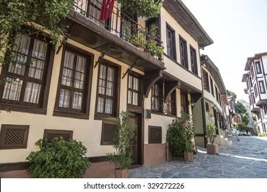 Bursa, Turkey - April 17, 2015: Wooden based Ottoman style architecture in a street in Tophane district of Bursa old town, Marmara, Turkey on April 17, 2015