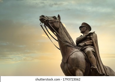 Bursa, Turkey - August 11, 2020: Bronze memorial statue of Mustafa Kemal Ataturk on his horse, the founder of the Republic of Turkey, over the sunset sky.