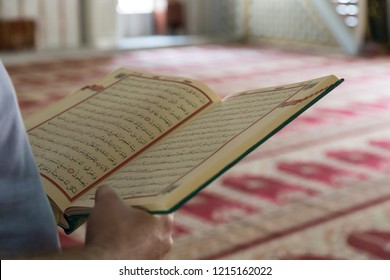Bursa/ Turkey - August 18, 2018 ; Koran and rosary beads in the mosque for Islamic concept. Holy book quran for Muslims holiday, Ramadan,blessed Friday message.