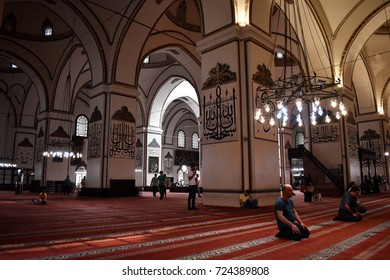 BURSA, TURKEY - AUGUST 29, 2017 : The Ulu Camii (Grand Mosque of Bursa) at noontime in Bursa in Turkey. The mosque was designed and built by architect Ali Neccar in 1396–1399.