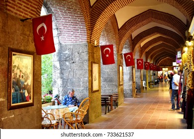 BURSA, TURKEY - AUGUST 29, 2017 : Koza Han (Bazaar) in Bursa in Turkey. Koza Han was built in 1491 and it is famous with pod and silk sale.