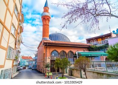 Bursa, Turkey - January 26, 2018: Exterior view of the ancient Kavakli Mosque in Bursa. Built in 14th century by Koca Naib (Naib the Great), the Qadi of Berussa, Sultan Murad Hudavendigar period.