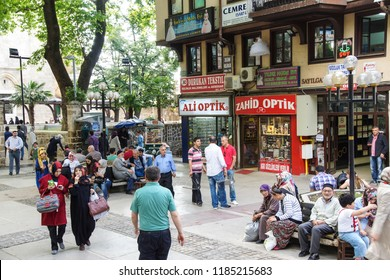 BURSA, TURKEY - MAY 22, 2014 - Turkish shoppers stroll by restaurants and shops    in the bazaar of  Bursa, Turkey