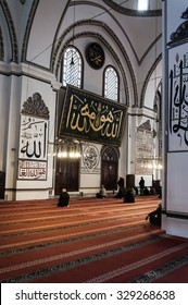 Bursa, Turkey - May 6, 2014: Interior view of Ulucami or the Great Mosque in Bursa with people praying and islamic style antique decoration on May 6, 2014