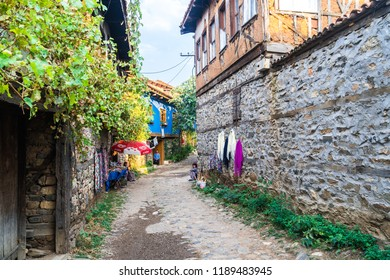BURSA, TURKEY - SEPTEMBER 01, 2018 : 700 years old Ottoman village Cumalikizik. It is popular with small tiny wooden and traditional houses and shops around cobblestone streets.
