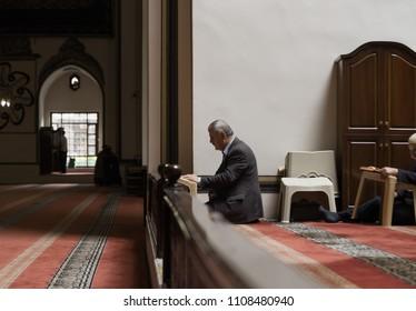 Bursa,Turkey,June 2018 : Religious muslim man reading holy book Al Qur'an in Grand Mosque.