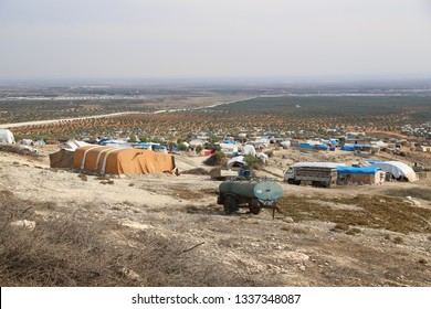 Burseya, Azez, Afrin, Halep/Syria-November 19 2019: Refugee camp for syrian people in Burseya hill, olive-tree, Azez,Afrin,Halep.