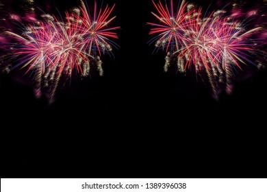 Bursting fireworks copyspace against black background celebrating the new year or the fourth of July indepence day  symmetrical