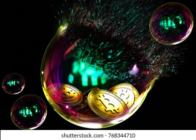 A bursting soap bubble with gold bitcoin coins inside, on a black background.