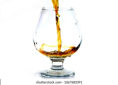 bursts and drops of strong liquor in a glass