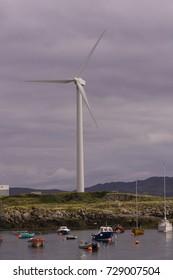 BURTONPORT, DONEGAL, IRELAND - AUGUST 17, 2006: Wind turbine, alternative power energy generator, in harbor area.