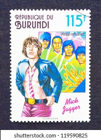 BURUNDI - CIRCA 1994: a postage stamp printed in Burundi showing an image of Mick Jagger and The Rolling Stones, circa 1994.