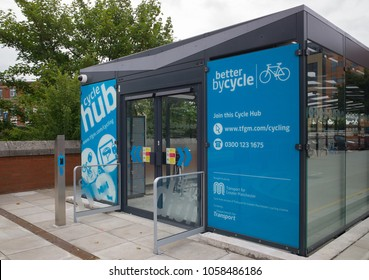 Bury, Greater Manchester / GB - August 17 2013: Cycle hub enclosed and secure parking for bicycles outside Bury Interchange public transport hub