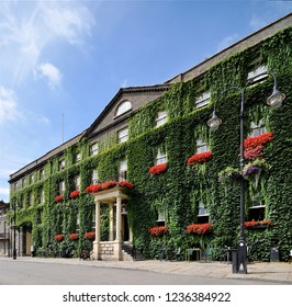 BURY ST EDMUNDS, SUFFOLK, UK - AUGUST 4, 2018. The Ivy covered Angel Hotel on Angel Hill at Bury St Edmunds in the English county of Suffolk, England, UK.
