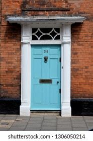 BURY ST EDMUNDS, SUFFOLK, UK - AUGUST 4, 2018. A blue door to an eighteenth century house at Bury St Edmunds in the English county of Suffolk, England, UK.