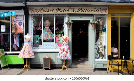BURY ST EDMUNDS, SUFFOLK, UK - AUGUST 4, 2018. A small old shop displays its vintage clothes outside at Bury St Edmunds in the English county of Suffolk, England, UK.