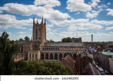 Bury St Edmunds, Suffolk, United Kingdom, June 7 2017: Skyline view of Bury St Edmunds Cathedral from to top of the Norman Tower with blue sky and white clouds
