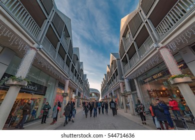 Bury St Edmunds, UK. 27th December 2016. People are walking through The Arc modern outdoor shopping precinct during the December sales.