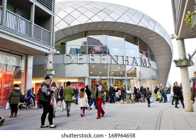 BURY ST EDMUNDS, UK - DECEMBER 27, 2013: Shoppers walk past the Debenhams department store in the Arc shopping complex after Christmas.