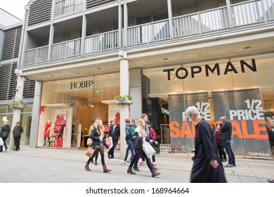 BURY ST EDMUNDS, UK - DECEMBER 27, 2013: Shoppers walk past high street stores in the Arc shopping complex after Christmas.