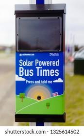 Bury St Edmunds, UK - February 21 2019:  A solar powered electronic bus times indicator on the Moreton Hall Estate