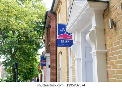 Bury St Edmunds, UK - July 12 2018:  Estate agent letting signs outside some townhouses on Looms lane in Bury St Edmunds