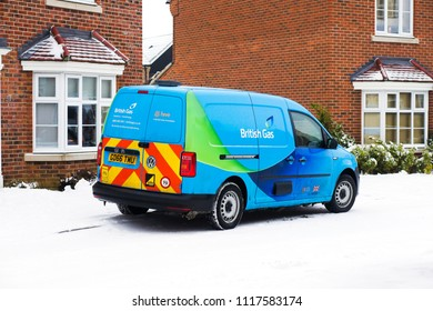 Bury St Edmunds, UK - March 1 2018:  A british gas repair van outside a modern home in Moreton Hall on a snowy day.