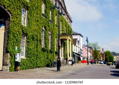 Bury St Edmunds, UK - May 15 2018:  A view of Angel Hill in Bury St Edmunds on a sunny day with the Angel hotel