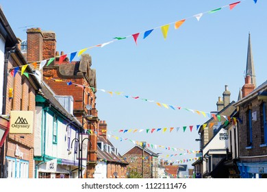 Bury St Edmunds, UK - May 15 2018: Colourful bunting flags over a street in Bury St Edmunds, UK