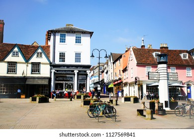 Bury St Edmunds, UK - May 15 2018: Angel Hill in the centre of Bury St Edmunds on a sunny way