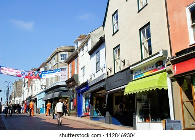 Bury St Edmunds, UK - May 15 2018: Shops and pedestrians on Abbeygate street on a sunny day