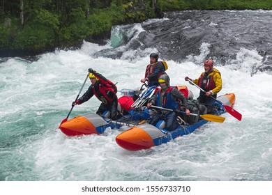 Buryatia, Russia - July 29, 2019: Sports catamaran on the rapids. The  Zhom-Bolok River. East Sayan, Buryatia, Siberia, Russia.
