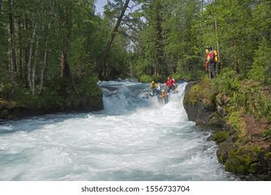 "Buryatia, Russia - July 31, 2019: Sports catamaran on the rapids. The ""Catapult"" rapids on the Zhom-Bolok River. East Sayan, Buryatia, Siberia, Russia."
