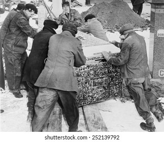 Burying Al Capone. Workmen at Mt. Olivet Cemetery in Chicago moving the vault with Al Capone's body. Feb. 6, 1947.