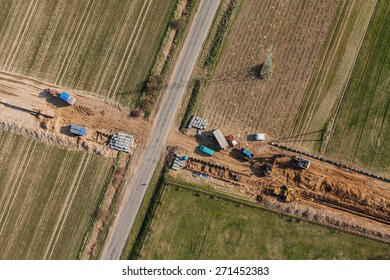 burying gas pipe in a country area in Poland