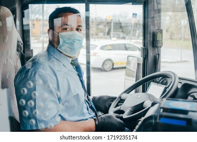 bus driver with mask wearing protecting gloves on his hand in bus to protect himself from the coronavirus epidemic. Pandemic coronavirus 2020. Quarantine. Virus concept. Epidemic infection.